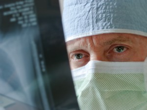 Healthcare Specialist Physician Surgeon Intensely Studies Xray Results before Surgery